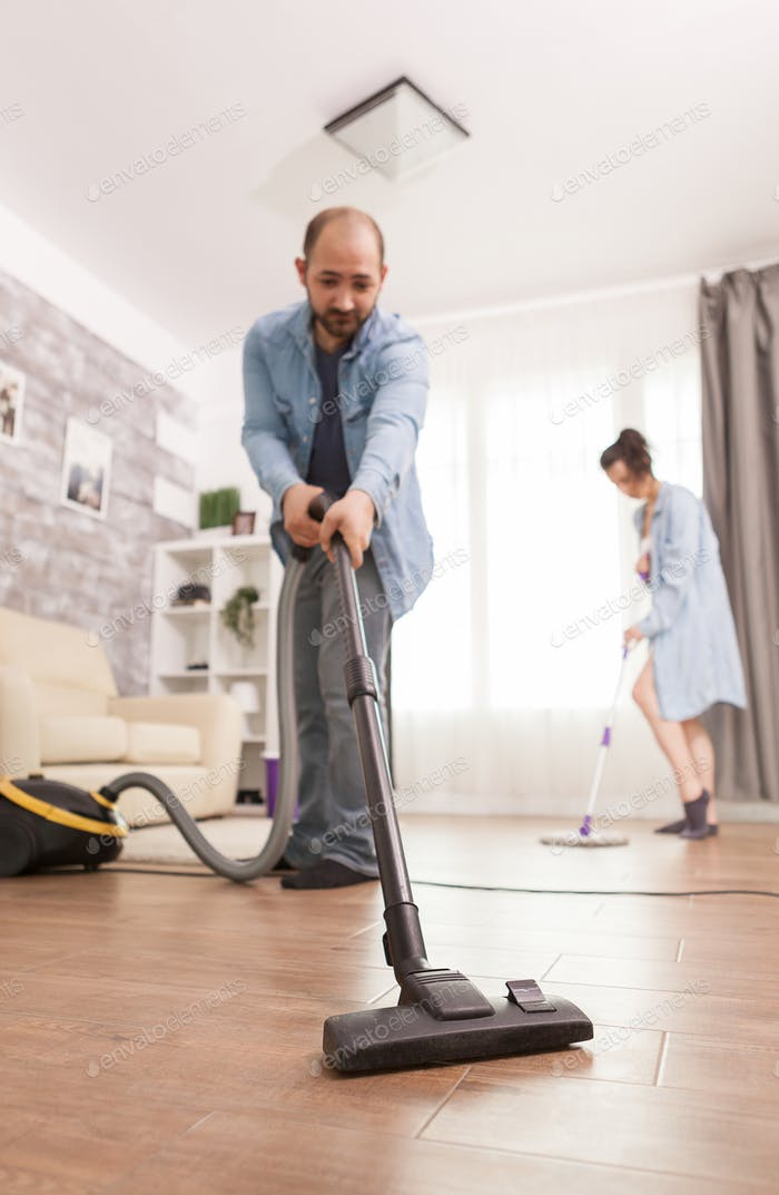 Cleaning floor with vacuum cleaner