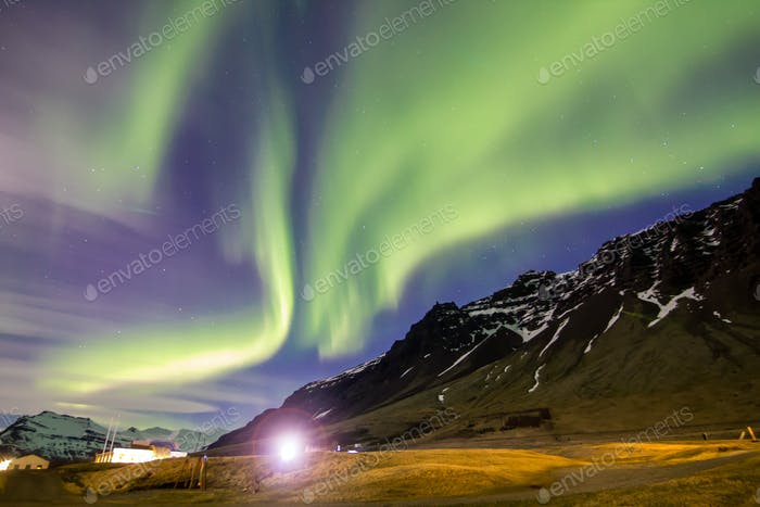 Aurora borealis or the northern lights with lens flare, Iceland, april 2016