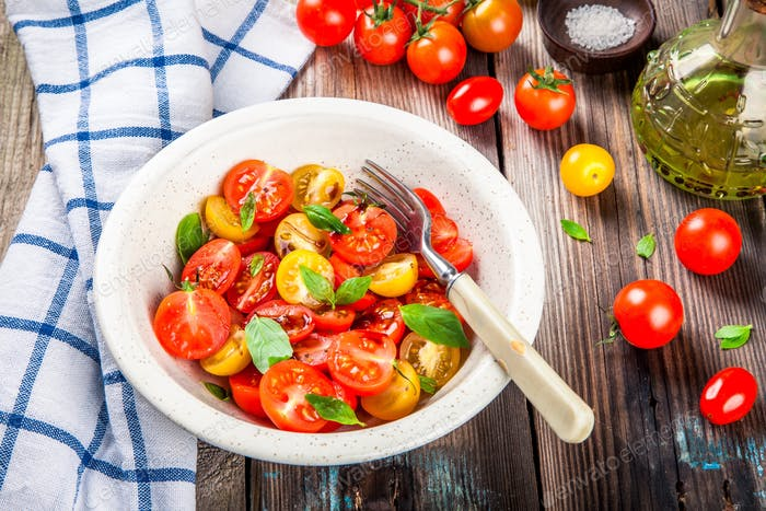 Salad of organic cherry tomatoes with basil, balsamic and olive oil