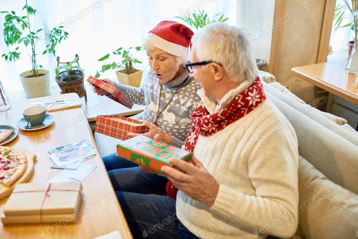Happy Grandparents Opening Christmas Presents