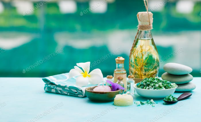 Spa and Wellness Massage Setting. Still Life with Essential Oil, Salt and Stones.