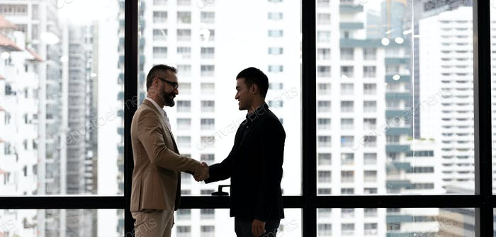 Business man handshaking with customer