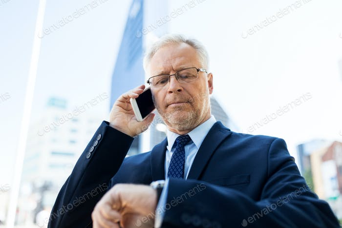 senior businessman calling on smartphone in city