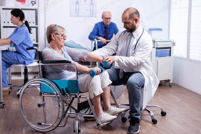 Physiotherapy for elderly woman in wheelchair