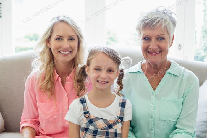 Grandmother with mother and daughter relaxing on sofa