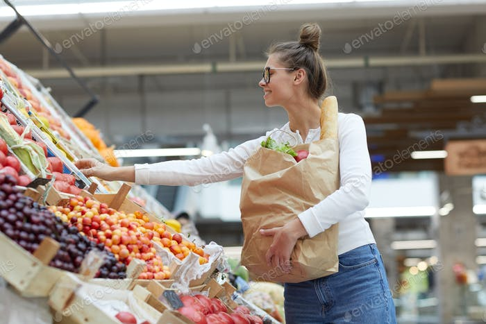 Young Woman at Fruit Stand