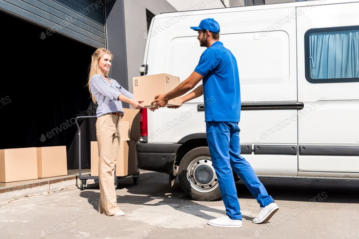 handsome courier giving package to beautiful woman