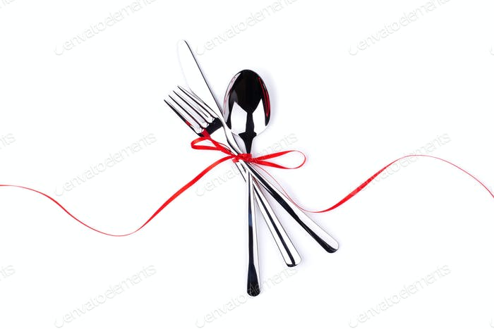 Fork, Spoon and Knife Tied with Red Ribbon.