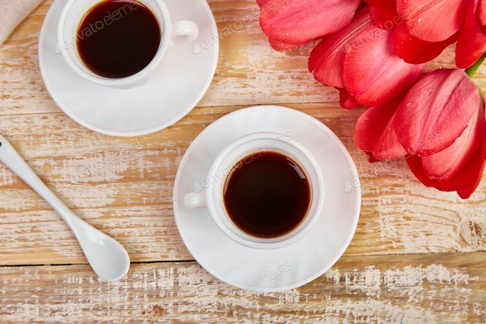 Two cup of coffee mug with pink tulip flowers