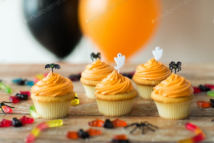 halloween party cupcakes and candies on table