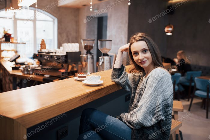 Cafe city lifestyle. Casual portrait of teenager girl. Toned.