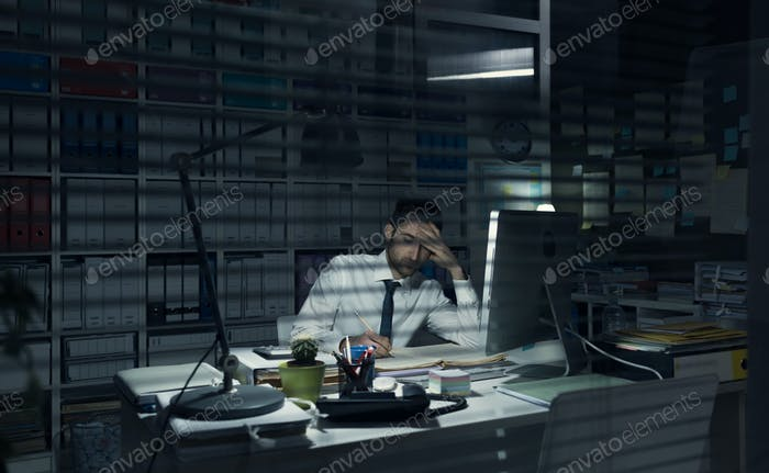 Business executive working late at night