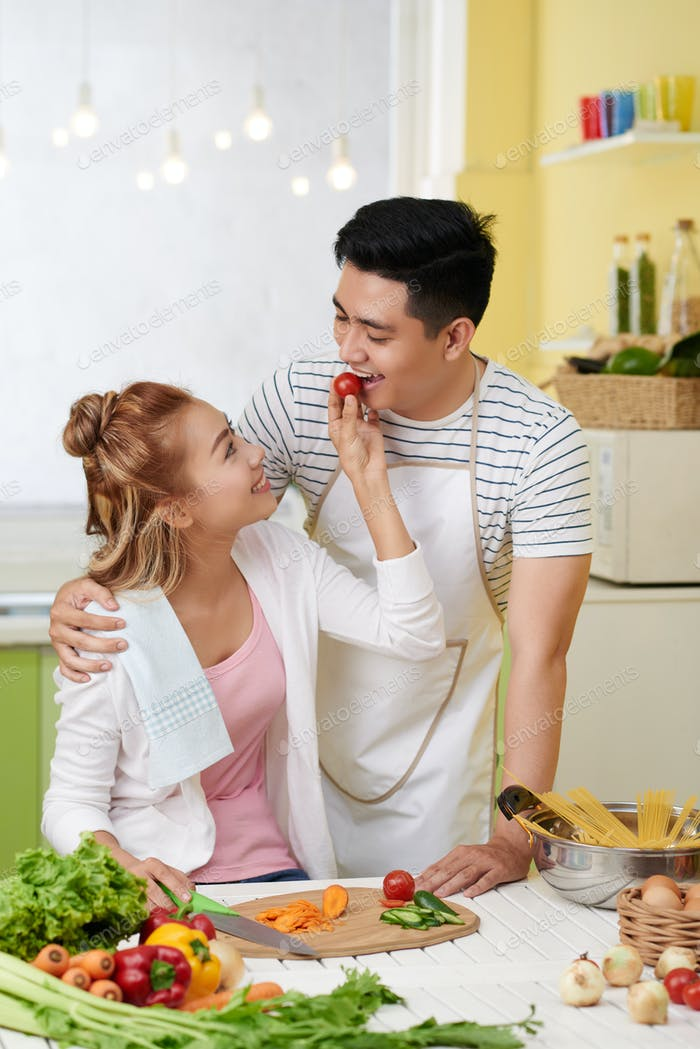 Couple in love cooking