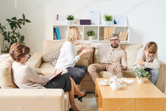 Stuffy mother speaking claims to father at therapy session