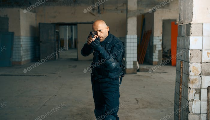 Man with gun, zombie apocalypse, abandoned factory