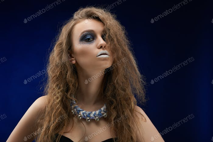 A photo of a charismatic beatiful girl with the artistic make-up