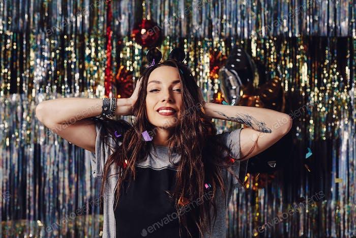 Portrait girl enjoying party and confetti