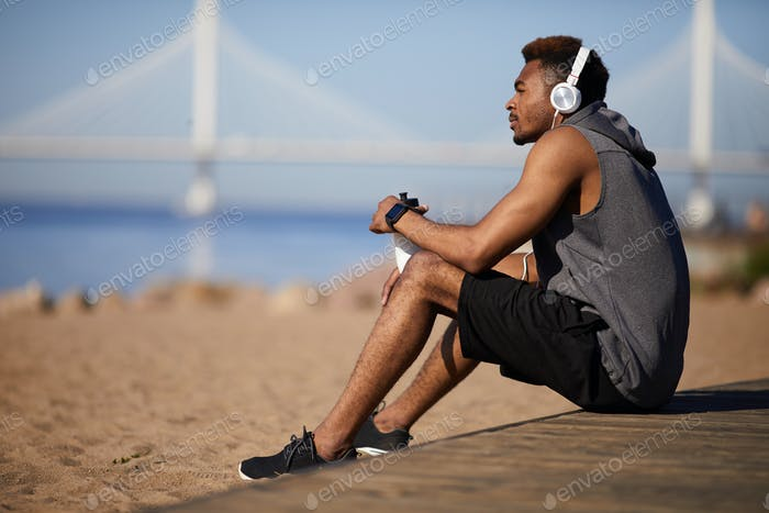 Thoughtful black man resting after training