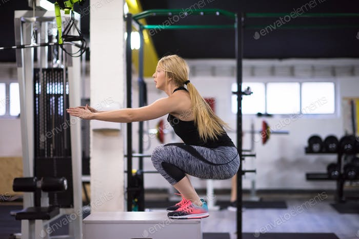 woman working out  jumping on fit box