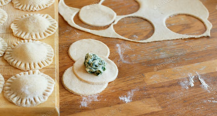 Making ravioli with ricotta cheese and spinach