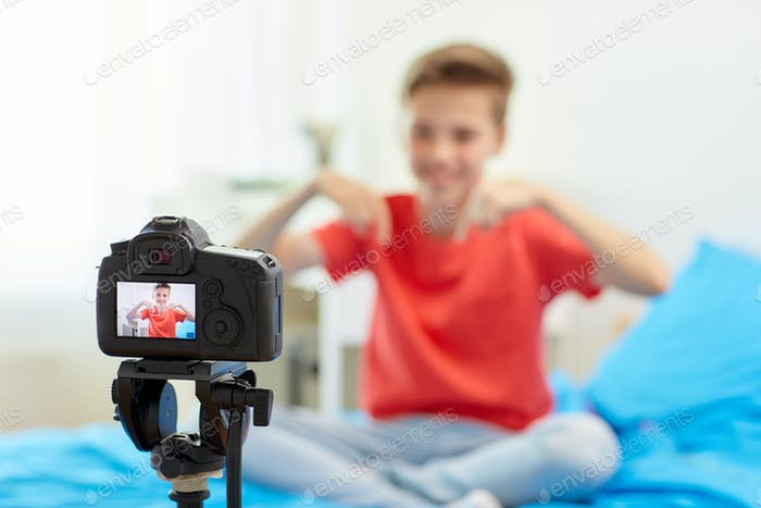 camera recording video of blogger boy at home