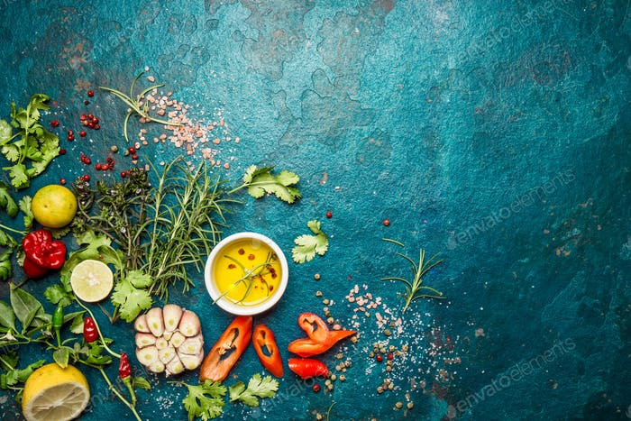 Food Background with Fresh Herbs and Spices. Blue Stone Background, Copy Space