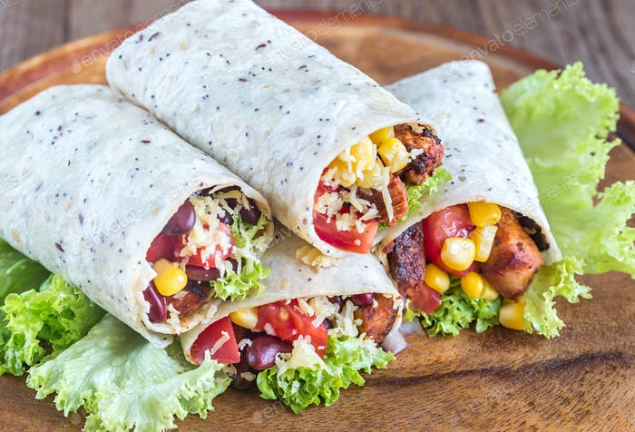 Three chicken burritos