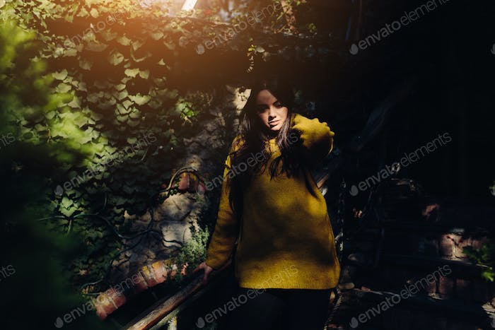 woman posing in the shade of of leaves
