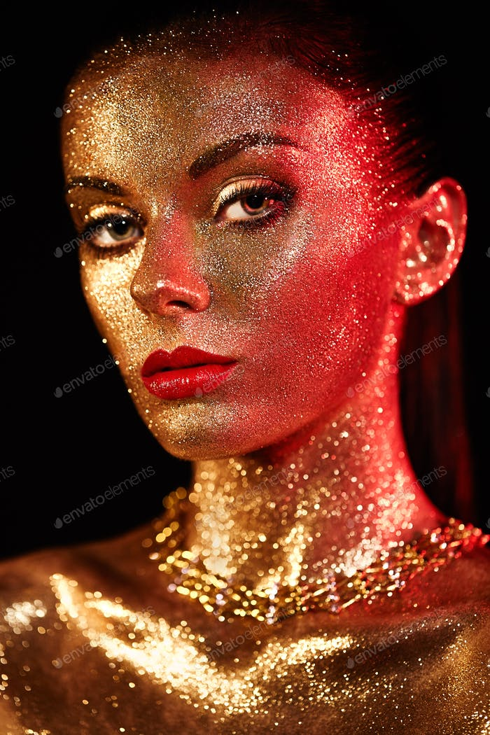 Thumbnail for Portrait of beautiful woman with sparkles on her face