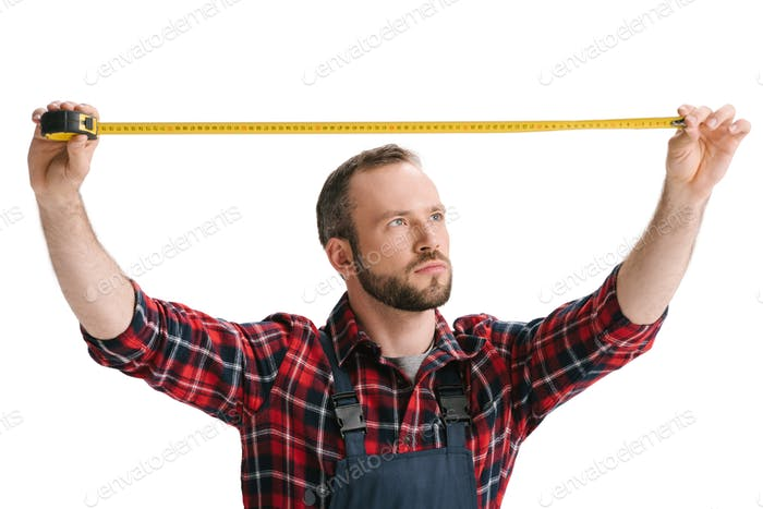 handsome construction worker with measuring tape isolated on white