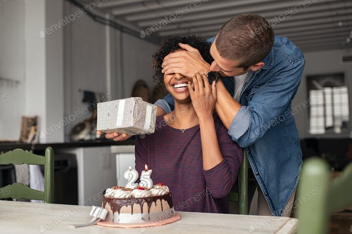 Man surprising girl on birthday