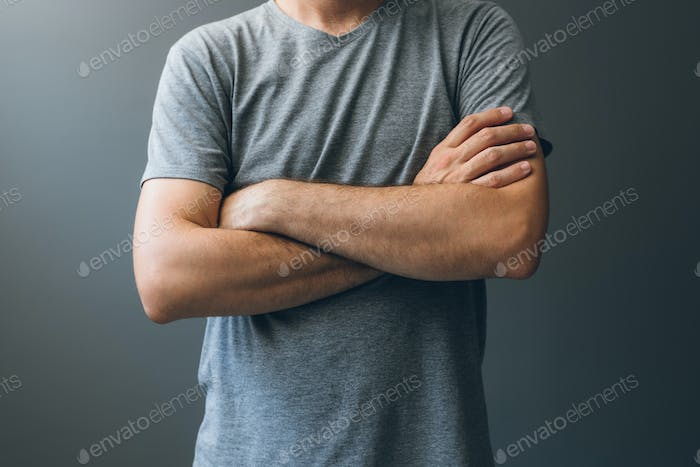 Casual adult man with arms crossed, body language