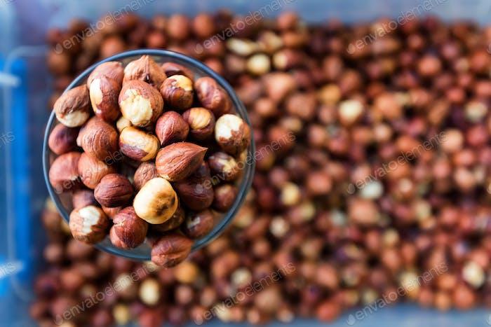Raw peeled hazelnut kernels for sale in market