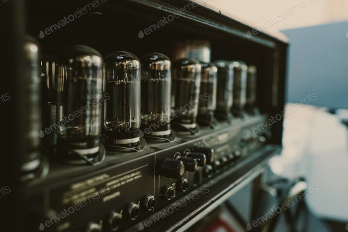 close-up shot of sound amplifier with lamps at recording studio