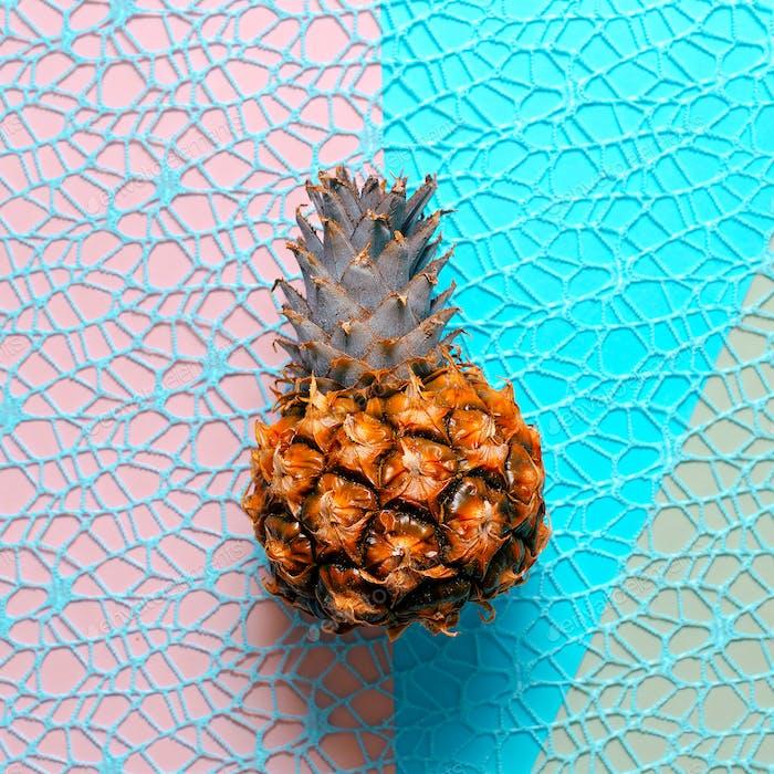 Mini pineapple on a stylish background. Minimal art