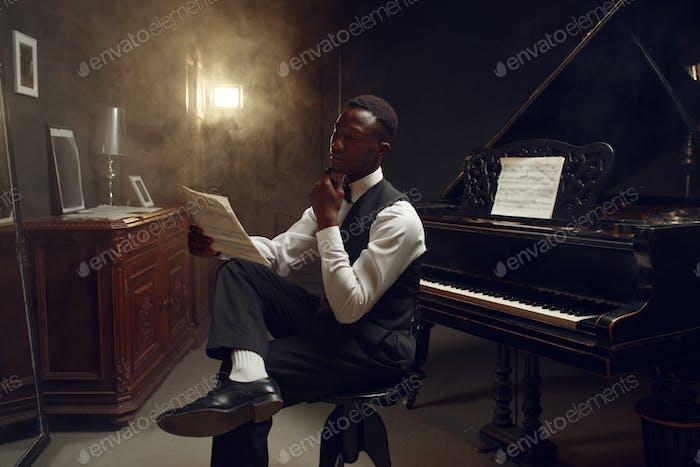 Stylish black grand piano player, jazz performance