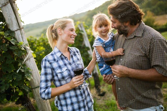 Wine grower family tasting wine