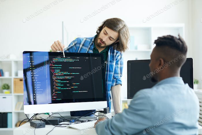 Coders discussing programming language