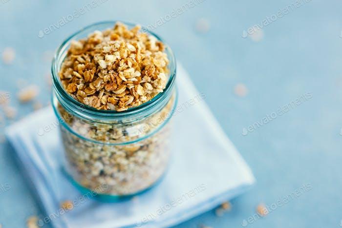 Homemade granola in glas on bright