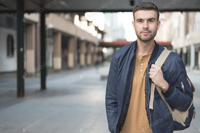 man with backpack smiling student