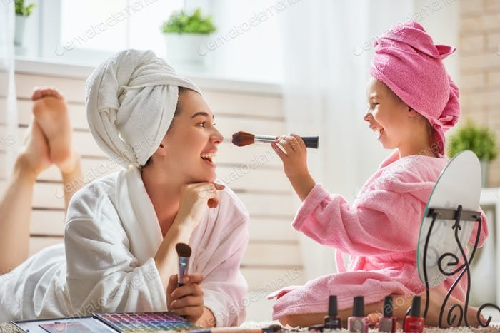 Mother and daughter are doing make up