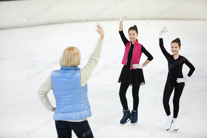 Female Coach Training Figure Skaters