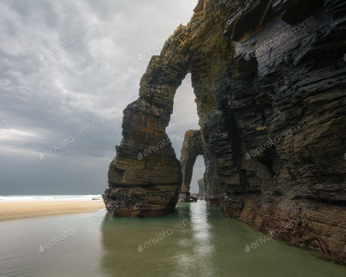 The famous stone arches of As catedrais beach on a cloudy day