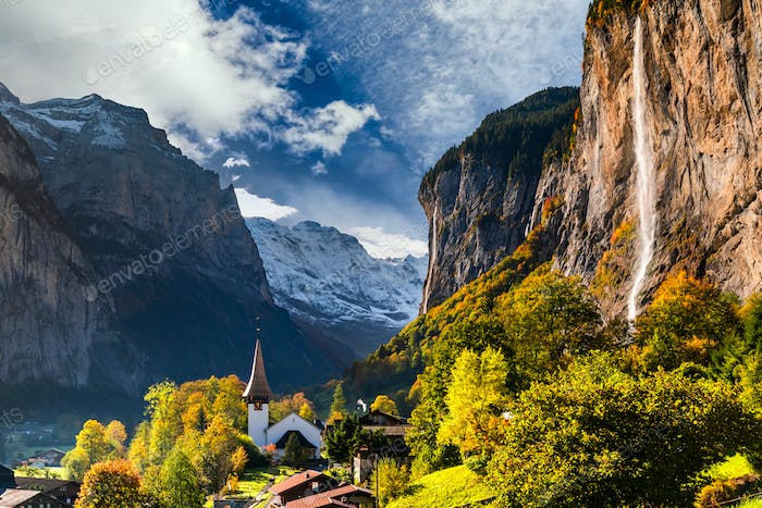 Famous Lauterbrunnen valley with gorgeous waterfall and Swiss Alps, Switzerland.
