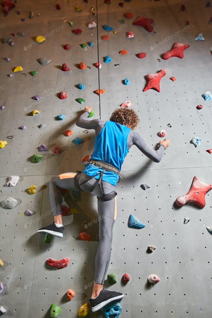 Climbing along wall