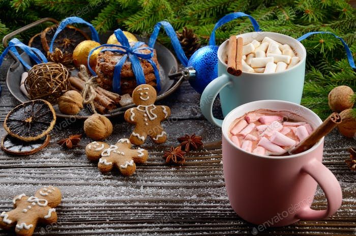 Christmas background of two mugs of hot chocolate with marshmallows