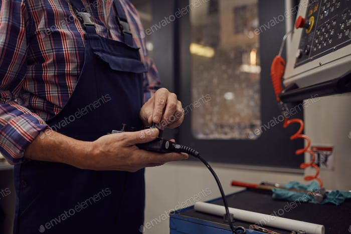 Worker using remote control