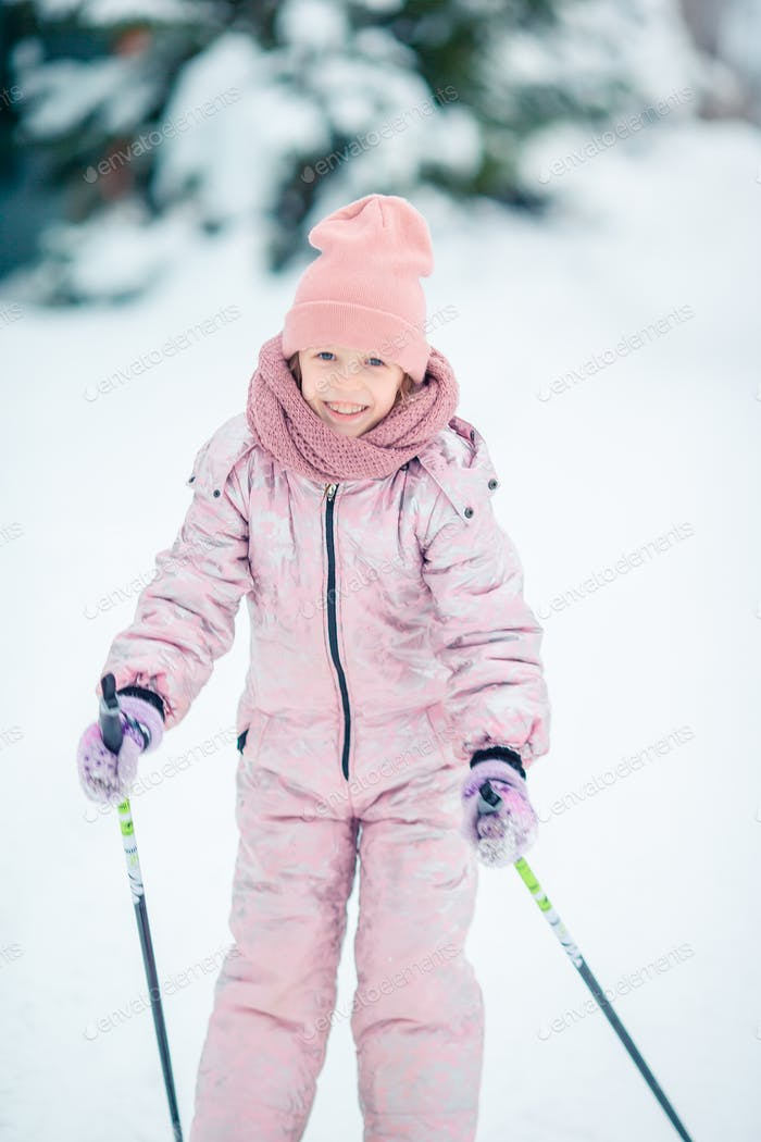 Child skiing in the mountains. Winter sport for kids