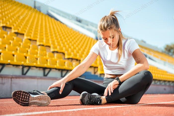 Woman resting at stadium