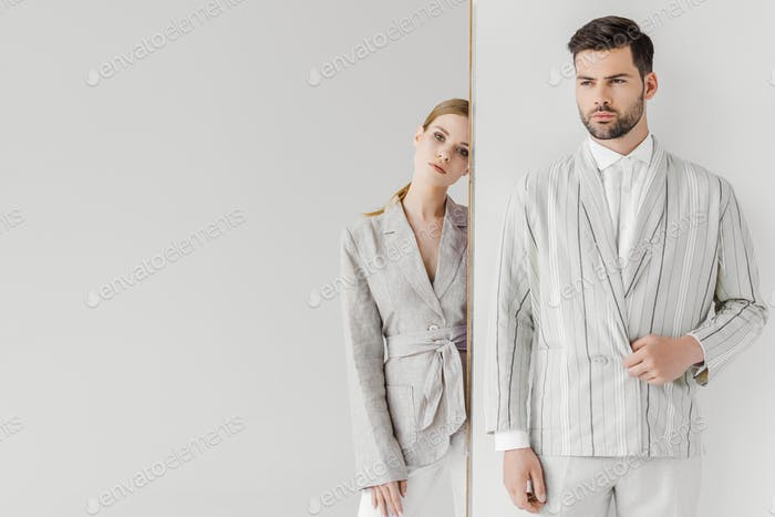 attractive male and female models in stylish vintage clothes on white